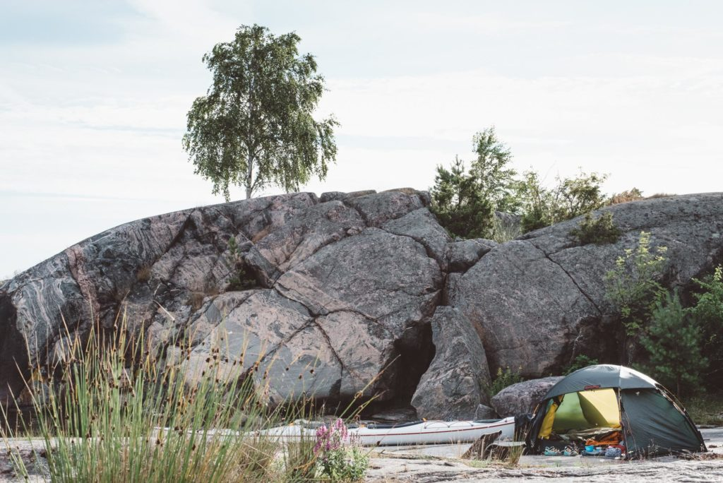 kayaks and tent on a rock